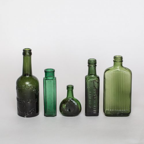Vintage green bottles for wedding hire